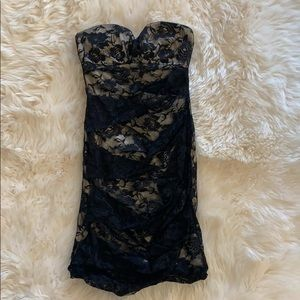 Black little lace bodycom dress.